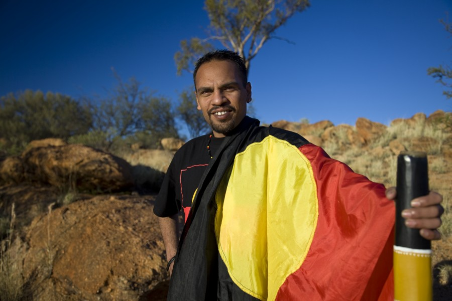 man with aboriginal flag